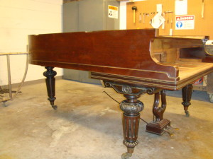 Brown Piano In Need Of Restoration In New Orleans Photo - Hall Piano Company