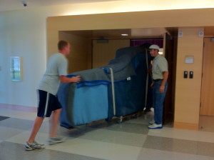 Piano Moving, New Orleans, Men Pushing Covered Piano Picture - Hall Piano Company